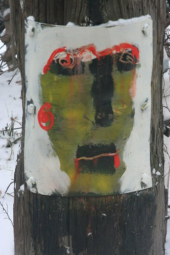 Painting on telephone pole--back alley Hyde Park