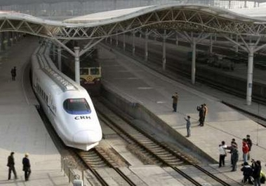 A bullet train pulls in at a railway station in Shanghai
