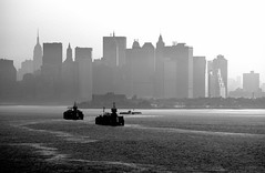 Arriving in New York (Greg Adams Photography) Tags: nyc bw usa newyork skyline boats harbor newyorkharbor spselection cy2 challengeyouwinner hhsc2000 travelerphotos news21