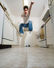 hi-ya! (poopoorama) Tags: selfportrait me kitchen digital 510fav jump nikon d70 sigma danny 1020mm day35 sigma1020mm 365days poopooramavoxcom 365explored superbmasterpiece utatajumps flickr:user=poopoorama