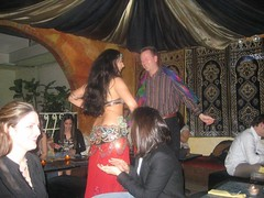 The Dude Dancing with the Belly Dancer spent the rest of his night making out with his girlfriend at the table adjacent to ours (Obreahny) Tags: dinner dancing obreahny lesouk nigerians bellydancernewyork