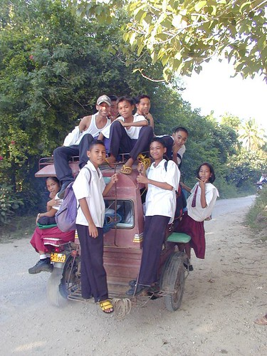 school days overloaded to rear sationary children tricycle view philippines pinoy boys girl tricycle transport filipino commuting bantayan cebu