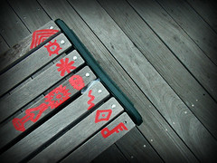Canal Street Icons (Mixxie Sixty Seven) Tags: wood red urban public bench graffiti wooden code icons providence scribbles scrawl symbols benches iconography cryptic