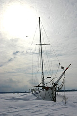 Winter Sailing VIII (James Patterson) Tags: winter lake snow ontario canada ice sailboat canon boat frozen sailing snowdrift canadian unusual nautical lakeontario 100club drift canadiana jamespatterson presquille 50club 50clubxcalidad wintersailing cans2s presquillebay flkwrk