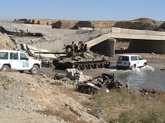 Bombed bridge and a tank stuck in the river on the road from Bagram to Kabul