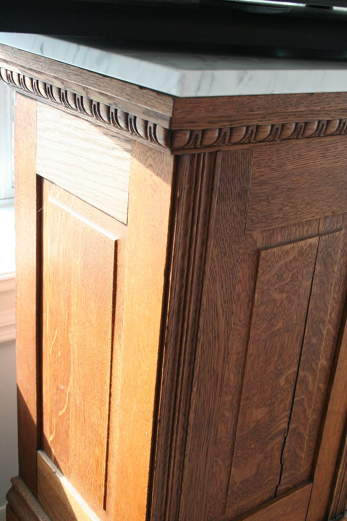 Oak pedestal with marble top and detail