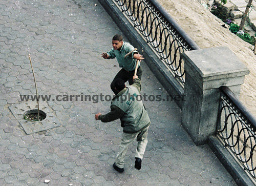 Gestapo attacking demonstrator with wooden stick