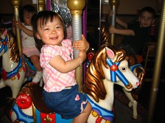 Ro can't believe how fun the merry-go-round is