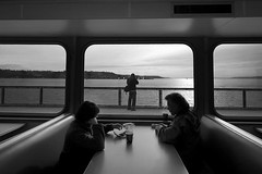 ferry to the mountains (puja) Tags: seattle blackandwhite bw topf25 ferry 350d topf50 topf75 strangers pugetsound canondigitalrebel bremerton thecorey bremertonferry sigma1020 tenpositive