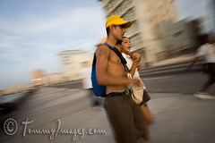 A young couple walks along El Malecon (tommyimages_com) Tags: life abstract motion boyfriend latinamerica horizontal speed walking blurry girlfriend couple havana cuba wideangle romance relationship cuban habana puppylove elmalecon ciudaddelahabana spanishspeakingcountries