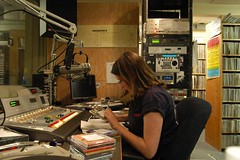 Student working a night shift job at a radio station