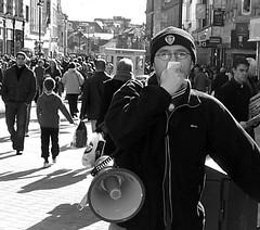 Political Canvassing: Socialist Worker (James W Bell (Good Honest Iago) - Leeds) Tags: people public politics protest leeds streetphotography pedestrians streetphoto unposed protestors briggate leedsunited socialistworker kodakz700 lufc peopleunposedinpublic jameswbell