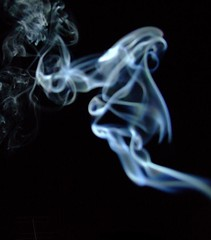 incense smoke abstract against night sky