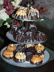 Flower cakes 12.24.06 b (Carissa Marie) Tags: cake chocolate chocolatedipped smallcakes pamperedchef floralcupcakepan