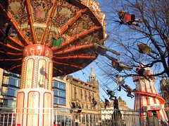 Flying Swings (photojennic) Tags: christmas xmas uk festival tag3 taggedout wonderful fun scotland cool edinburgh downtown tag2 niceshot tag1 fairground britain swings great scottish princesstreet greatshot helterskelter verycool photojennic bestof2006 cotcbestof2006 thechallengegame challengegamewinner msh0809 msh08095 thephotoproject