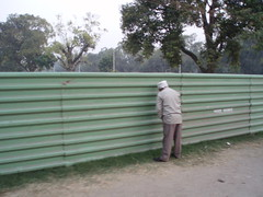 Leak on Fence (Indian Ink) Tags: india man delhi peeing indiagate