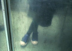 the feet in the elevator (kyaralao) Tags: reflection feet photoshop dark shoes sad elevator dirty sneakers fluorescent converse lonely