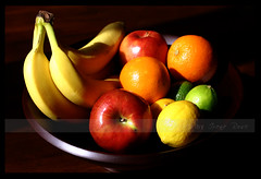Still Life Of Fruits (babybee) Tags: colors fruits naturallight lemons explore bananas bodegn exploreinterestingness apples citrus oranges arrangement limes tabletop fruitbowl freshfruits fruitbasket flickrexplore stillnature creativephotography explored exploretop500 abigfave fotografikas stilllifeoffruits fruitsonthetable burstofcolors fruitsonatable tasteoffruit