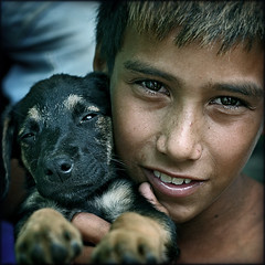 A sense of belonging... (carf) Tags: poverty friends boy brazil dog boys brasil kids youth puppy children hope kid community puppies education support child risk friendship culture esperana social impoverished underprivileged altruism educational development prevention soe cristian cultural petita atrisk blueribbonwinner mundouno shieldofexcellence anawesomeshot impressedbeauty superbmasterpiece flickrdiamond