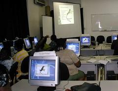 Teachers exploring a Jamaicanized TuxPaint for curricula ideas