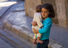 Young Girl With Her Brother, Aleppo, Syria (Eric Lafforgue) Tags: street woman baby color colour girl look horizontal female child sister femme bodylanguage shy innocence syria bebe rue damascus fille twopeople unescoworldheritage aleppo regard damas middleeastern siria  levant syrien syrie 282 sirja alep traveldestinations suriye lookingatcamera   syri lafforgue  89years sria szria  westernasia    suriah sirija  cp  sora
