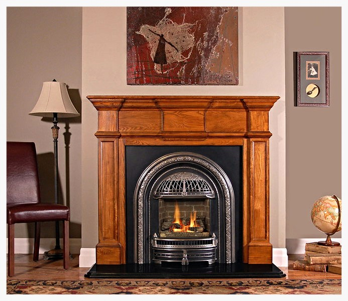 BARRINGTON  The Barrington is our newest addition. We wanted a mantel with simpler lines that echoed some of the Federal design elements that were found in early American homes. This mantel's slightly larger scale works with any heritage décor.
