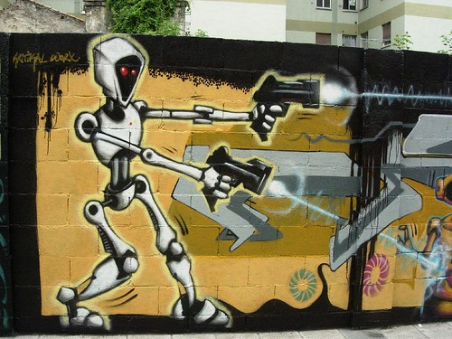 graffiti robot art on cement brick wall