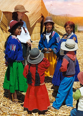 Uros Islanders (Trapac) Tags: blue red summer people green peru laketiticaca southamerica yellow reeds children geotagged culture puno urosindians indiginous bfbeforeflickr geo:lat=15773752 geo:lon=69952698