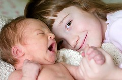 sisters (-Angela) Tags: 2005 girls topf25 sisters canon yawn 2550fav notmykid newborn personalfavorite client 10daysold missv