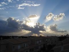 Rainy day sunset (rvidal) Tags: light sunset portugal clouds faro rays