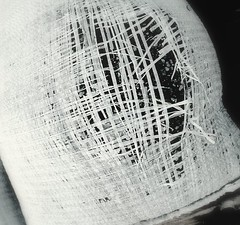 cross stitch (mle.punk) Tags: b white black bag emily sand cross hole stitch w holes dirt woven sandbag unraveling unravel paup emilypaup