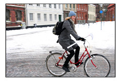 How's Sweden? - B L O N D (Nicoze) Tags: street winter people snow lund color girl bike bicycle sweden blond nicolas panning bandy masse nicoze indoorbandystick