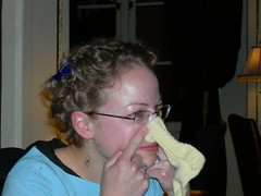 april putting a baby sock on her nose