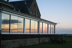 Sunrise reflected in conservatory windows (foxypar4) Tags: reflection sunrise scotland sutherland dornoch royalgolfhotel