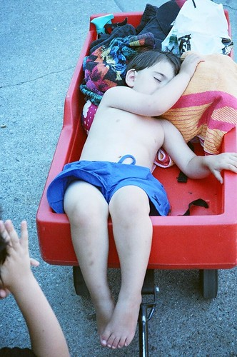 Asleep in a red wagon