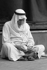 Goldleaf - Cigarette (Hussain Isa) Tags: world old people bw slr face digital canon eos sadness gold blackwhite bahrain sad cigarette smoke oldman wb smoking explore human 10d someone dslr coolest manama goldleaf duraz himd supershot explorex flickrdiamond hussainisa streetphotographycandidphotography