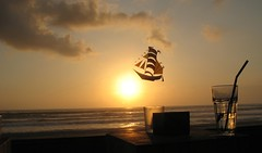 Ship shaped kite, KuDeTa (John Mason) Tags: travel sunset vacation sky bali sun holiday beach indonesia geotagged october asia 2006 arrr pirateship seminyak kudeta johnmason beautifulbali