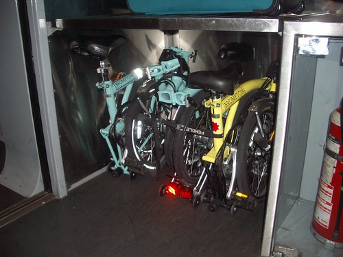 Folding bikes – pictured here on the Eurostar – fit easily into almost any train baggage area. They're also accepted as hand luggage on nearly all bus services. Photo: roggieLondon