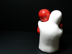Embracing (tanakawho) Tags: red white pepper interesting salt shaker shape onblack embracing artisticexpression 1on1objects theunforgettablepictures