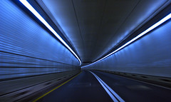 A tunnel outside Baltimore (...like a chimp with coconuts) Tags: lighting blue motion blur lines movement traffic empty tunnel baltimore curve chesapeake drivebyshooting i95 img6640
