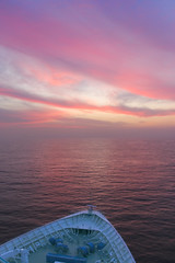 sunrise at sea ((nz)dave) Tags: california morning travel cruise pink blue vacation color colour reflection water sunrise landscape mexico dawn boat nikon soft ship purple pastel vessel 1870mmf3545g bow ensenada d200 february nikkor royalcaribbean mx gentle daybreak 2007 monarchoftheseas nikond200 5photosaday explore02mar2007 intersetingness416