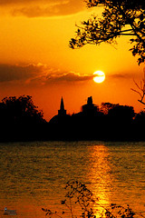 Eternal Sunset (Thishya Weragoda) Tags: sunset sun lake reflection water clouds reflections pagoda stupa sri lanka srilanka stillwater eternity anuradhapura blueribbonwinner culturaltriangle ruwanweliseya dageba anawesomeshot impressedbeauty superbmasterpiece diamondclassphotographer ysplix top20srilanka nuwarawewa apura theperfectphotographer chitya