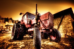 old style tractor (gari.baldi) Tags: red brown tractor yellow canon germany 350d antique gimp wideangle glowing garibaldi soe hdr orton usedom 2007 lightroom trecker paperwall sigma1020 1xp abigfave klpinsee superaplus aplusphoto superbmasterpiece
