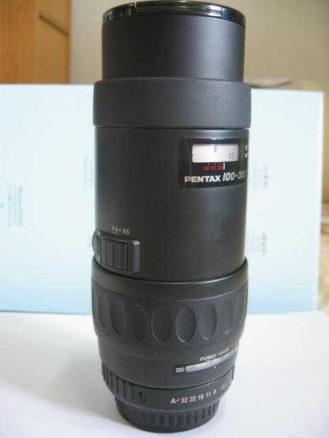 請PFC的先進幫我介紹一下這顆鏡頭FA 100-300
