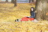 Yuki on yellow carpet. (Yuri Figuenick) Tags: woman portrait fall autumn japanese asian longhair book reading fashion canon eos 5d markiii 135mmf2l yellow leaves fallenleaves ginko focus dof