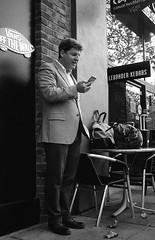 2-Bags (Tim Roper) Tags: 35mm id11 leica paloalto hp5 street man phone film