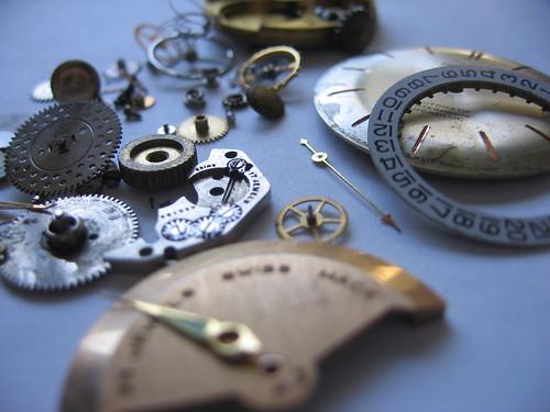 broken clock in lots of pieces