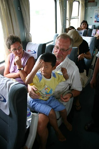 My dad with a Vietnamese kid in the train back to Saigon...