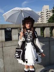 Dude looks like a lady... (vyxle) Tags: pink red black japan tokyo cosplay bodylanguage lolita harajuku transvestite gothiclolita yamamba crossplay yamanba gololi