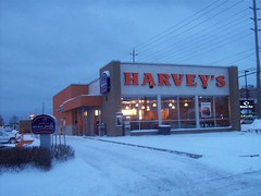 Merivale Harvey's (Steve Brandon) Tags: roof winter sky snow ontario canada sign logo geotagged restaurant gloomy bell cloudy snowy hiver ottawa fastfood cara frenchfries payphone cheeseburger hamburger drivethru signage suburb neige nepean drivethrough harveys franchise  bellcanada quiznossub  overheadwires paytelephone merivaleroad merivalerd ruemerivale viewmountdrive viewmountdr promenadeviewmount harveysmakesyourhamburgerabeautifulthing itsabeautifulthing tasdugot caraoperationslimited caraoperationsltd
